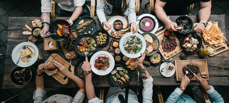 Table with food, top view. (Olga Klochanko/Shutterstock)