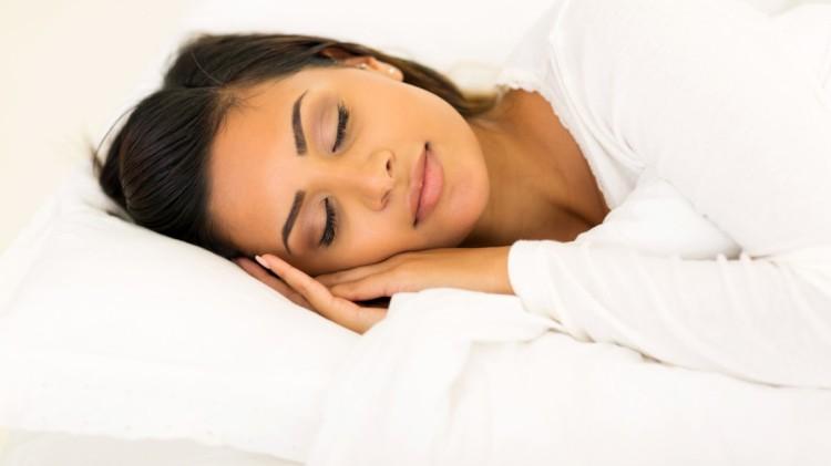 cute woman sleeping in bed